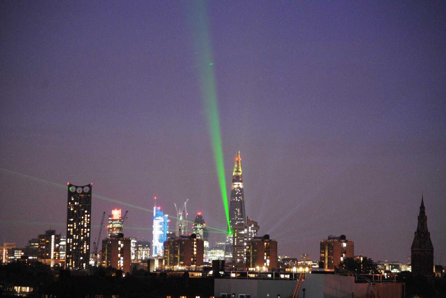 A dozen emerald-green laser beams emanated from the Shard to pick out iconic landmarks including the London Eye, St. Paul's Cathedral and Tower Bridge (1016-ft) Shard in London (Photo: Jenny Brown)
