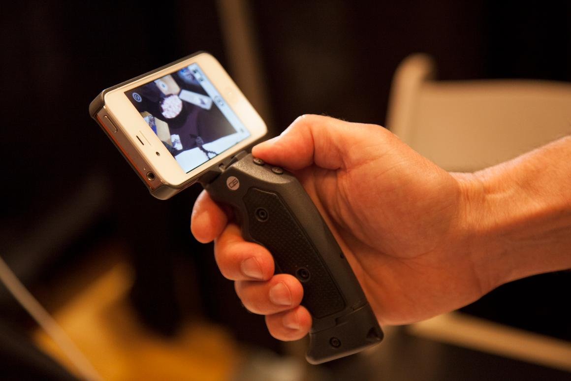 The Grip & Shoot system attaches an ergonomic pistol grip to an iPhone and connects via Bluetooth, providing greater control when taking photos and shooting video
