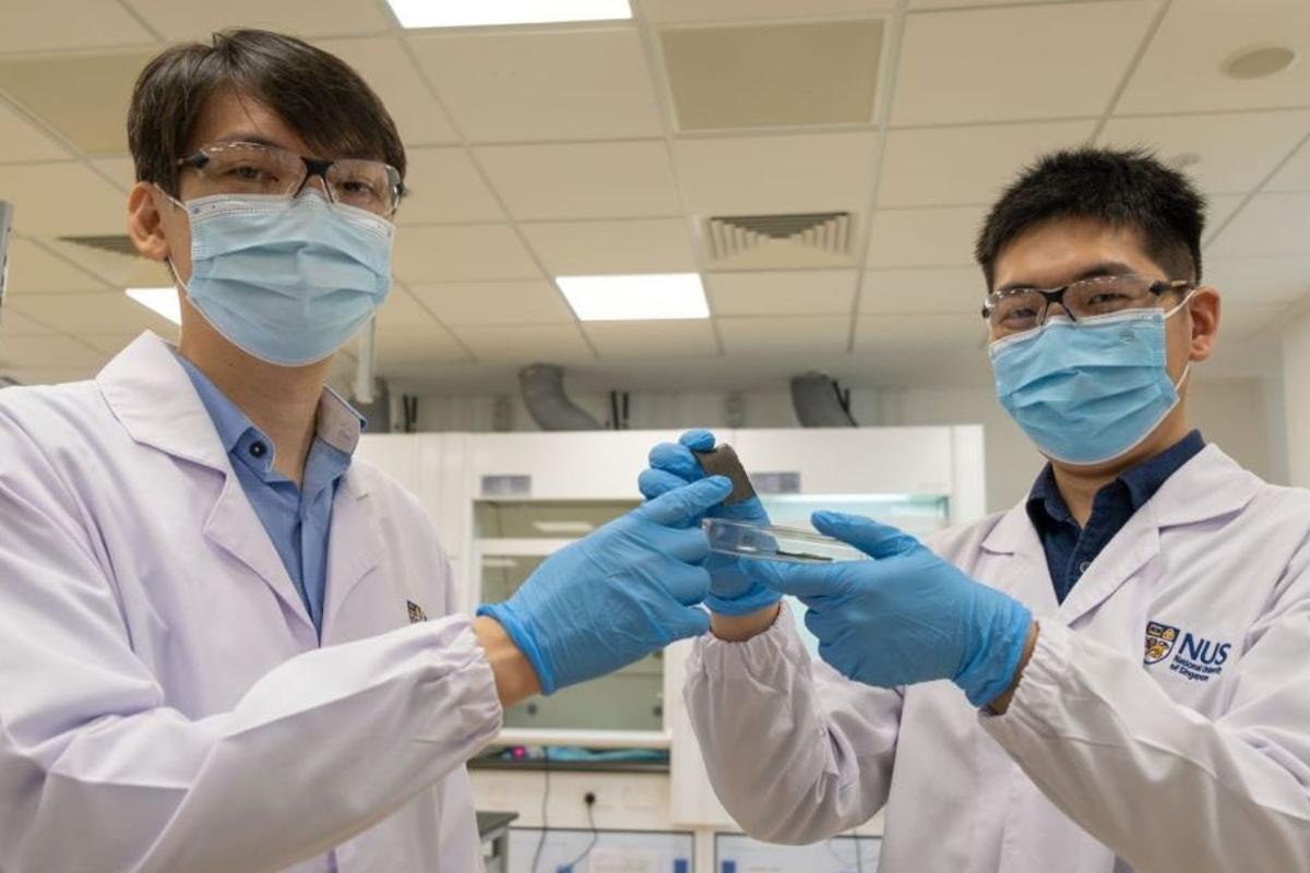 Asst. Prof. Benjamin Tee (left) and Mr. Guo Hongchen, with a sample of the AiFoam