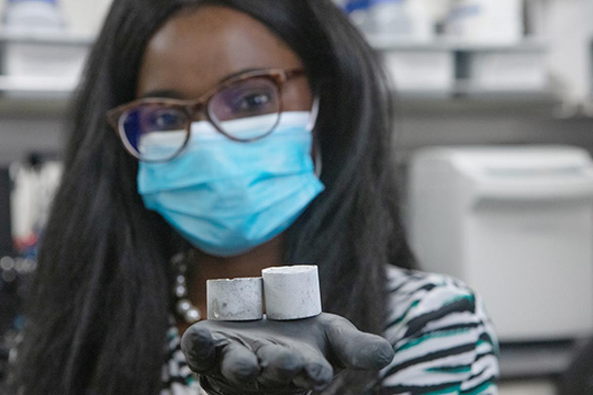 Study author Ange-Therese Akono with a sample of graphene-infused cement