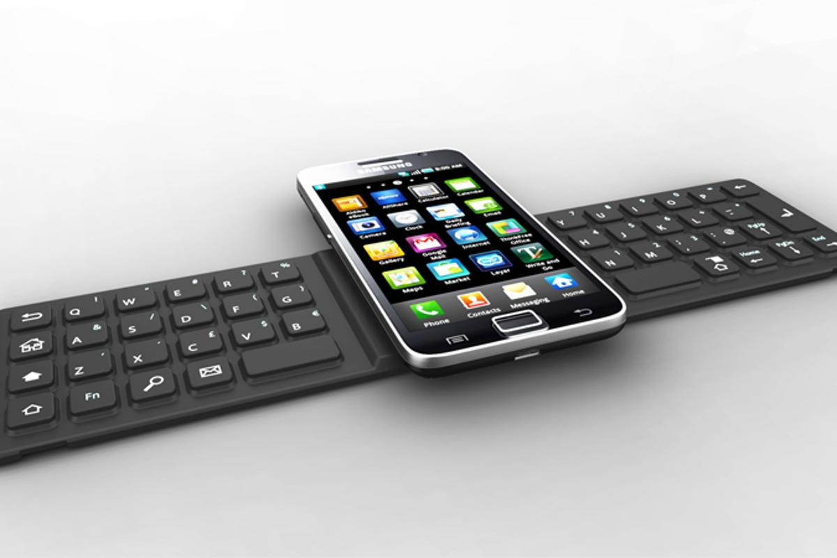 one2TOUCH silicon keyboard operates when a smartphone is set on top of the center pad