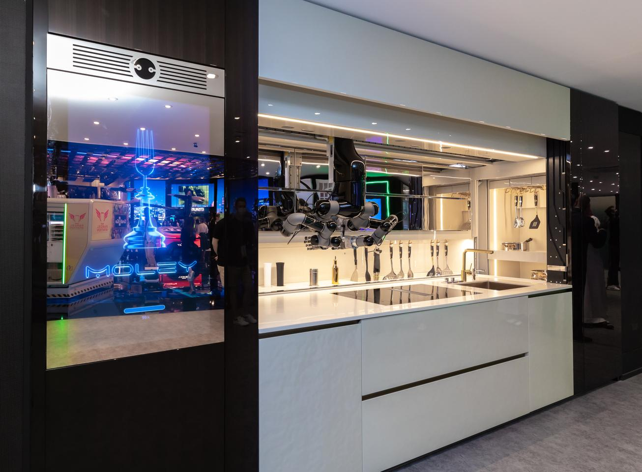 The Moley R kitchen is a complete installation with appliances, robotics, GUI, cabinets and cookware
