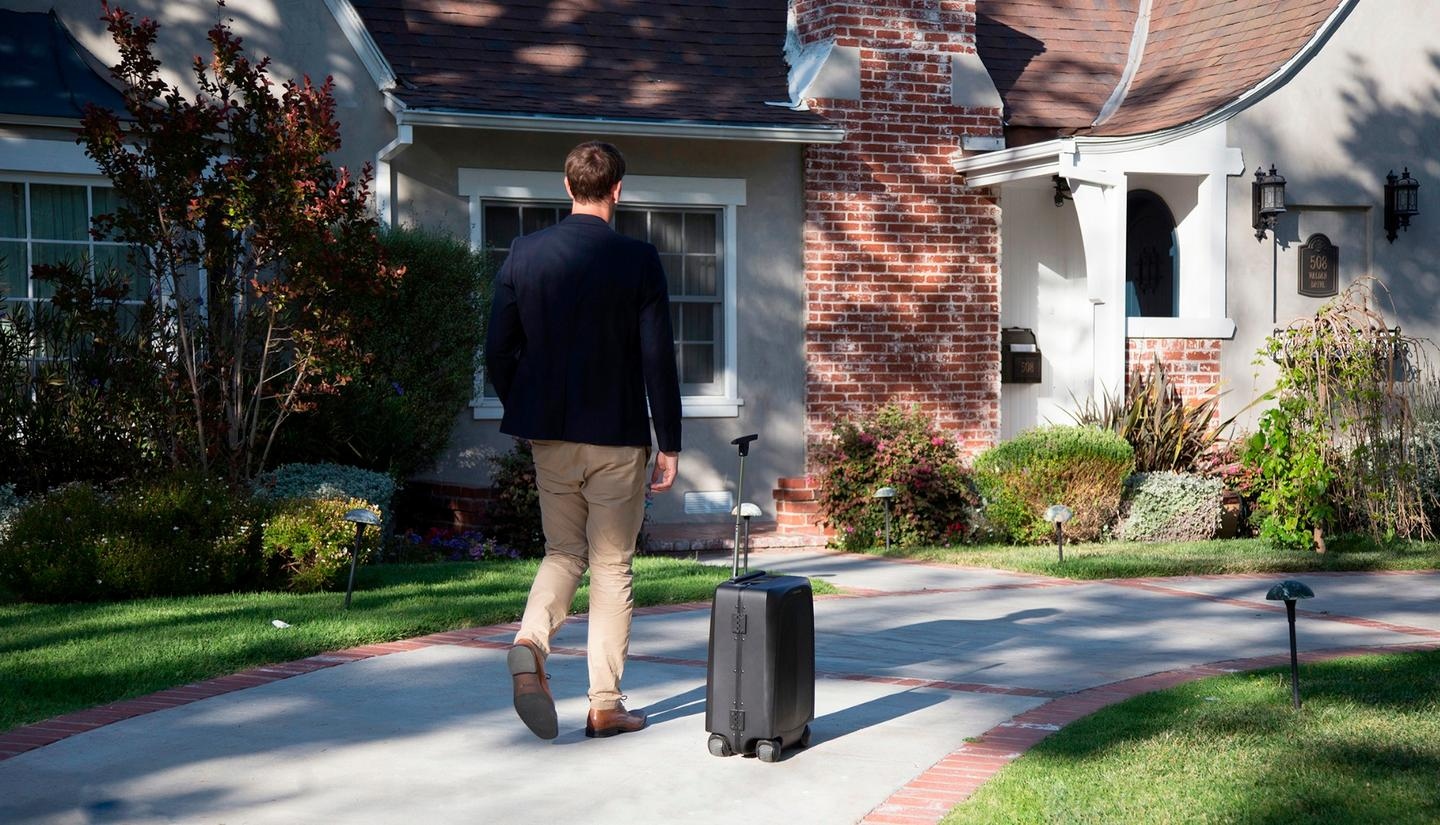The Ovis suitcase follows along beside its user