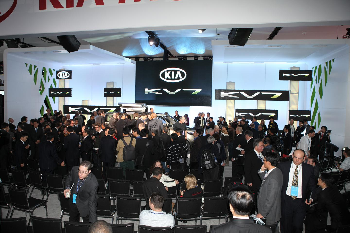 The media pack surrounds the Kia KV7 Concept at its unveiling in Detroit