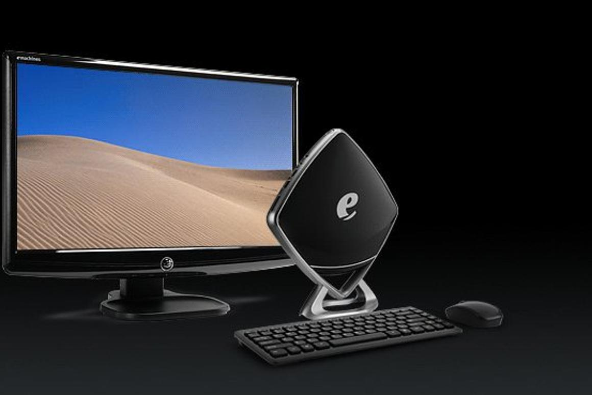 The glossy black diamond shape of the Mini-e from eMachines could well see it take front stage on a user's desk instead of being hidden behind monitors like others of its kind