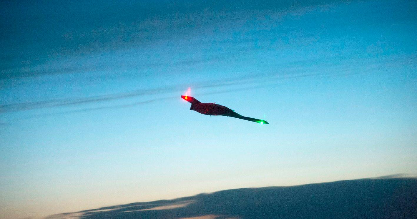 The X-47B, shown here on its first night flight in April, is set to begin its next round of sea trials (Photo: US Navy)