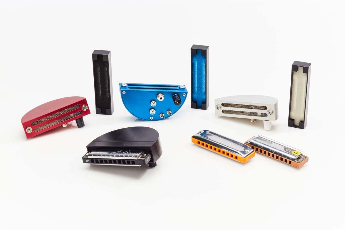 A harmonica is placed in the gasket and attached to the main Dyna-Mic body, which distributes the sound evenly before it's picked up by the internal microphone