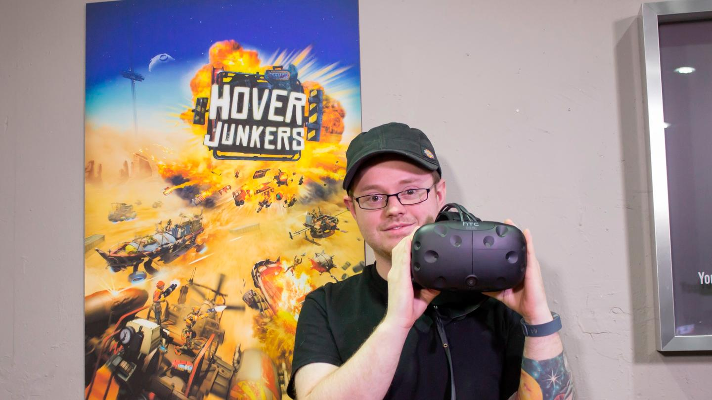 StressLevelZero co-founder Alex Knoll, showing off the Vive headset his game will play on
