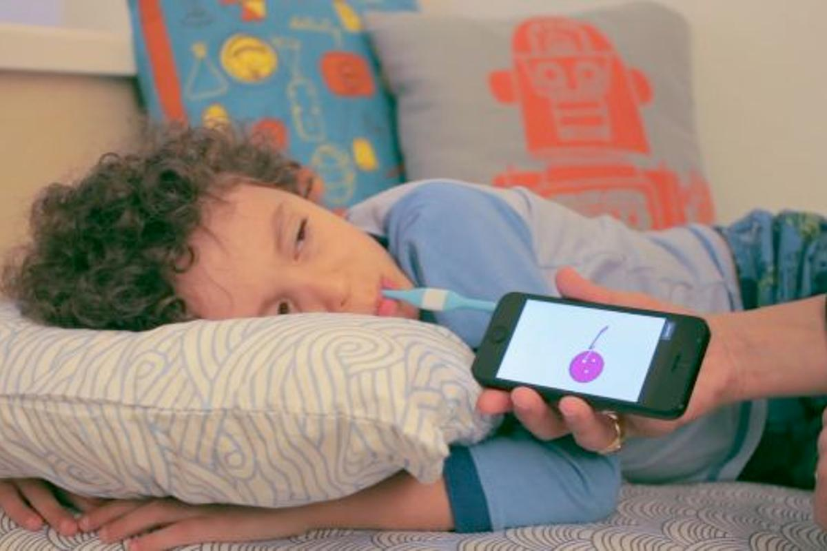 The Kinsa Smart Thermometer in use