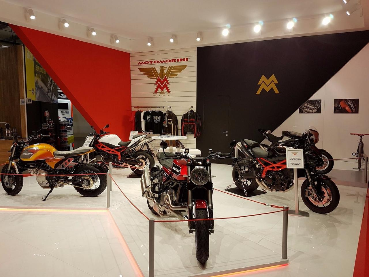 Moto Morini has escapedfrom financial difficultiesand returned with two new versions of its 1200 cc V-twin. The red Milano (center) and the yellow Scrambler (left) feature mainly cosmetic changes