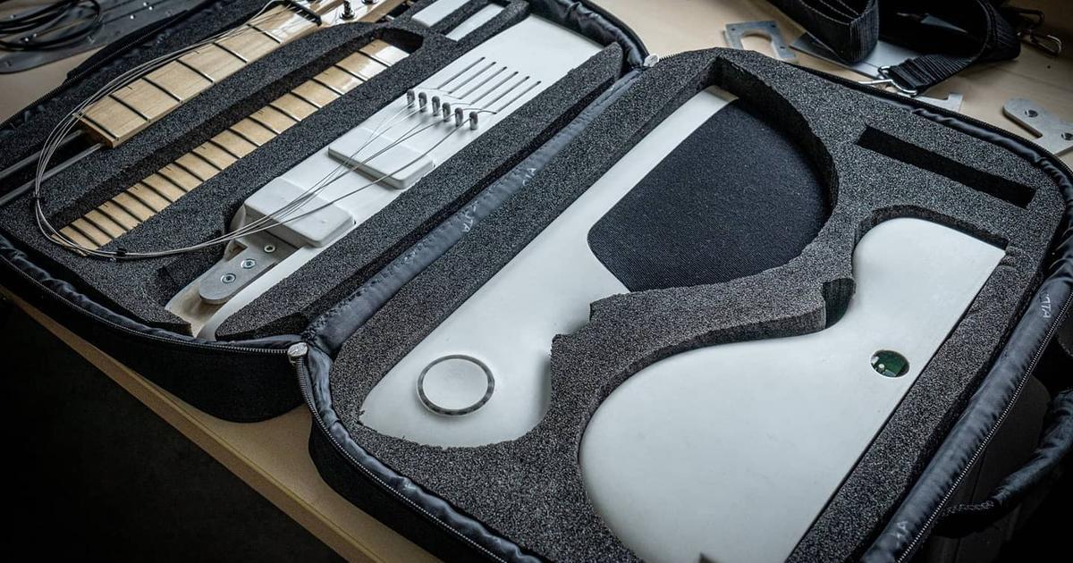 Modular travel guitar packs down into a laptop case
