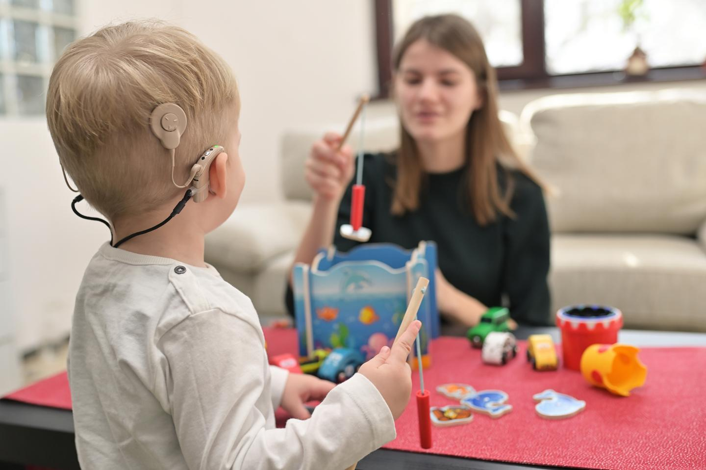 A child with conventional cochlear implants