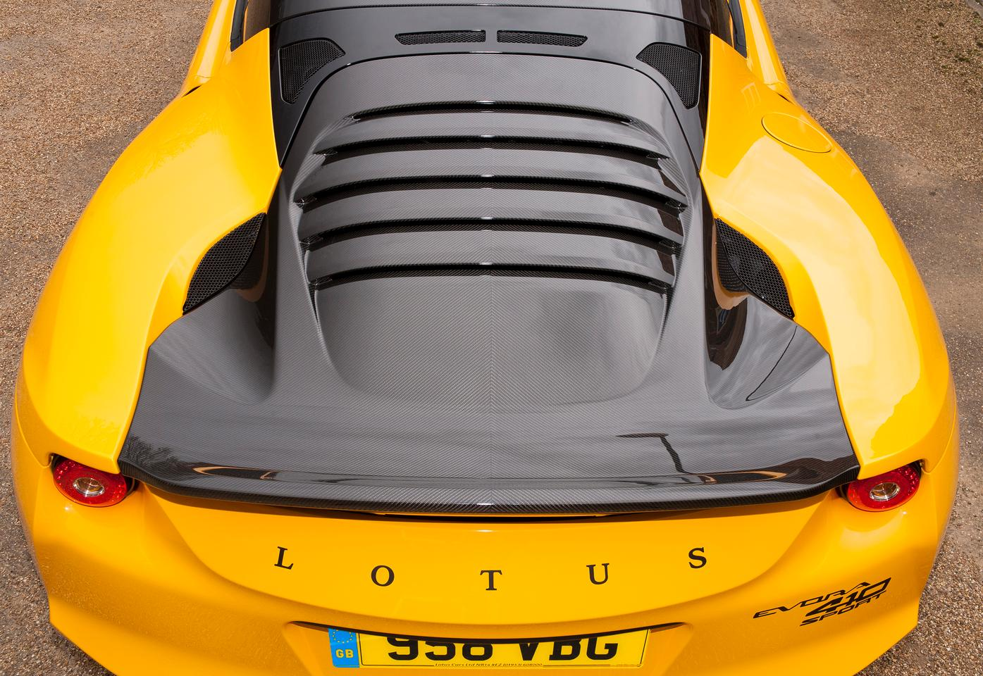 The Evora Sport 410 has a carbon fiber tailgate with integrated rear spoiler and louvered backlight