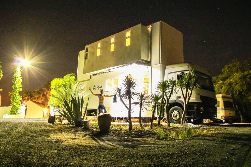 The Truck Surf Hotel lit up after dark
