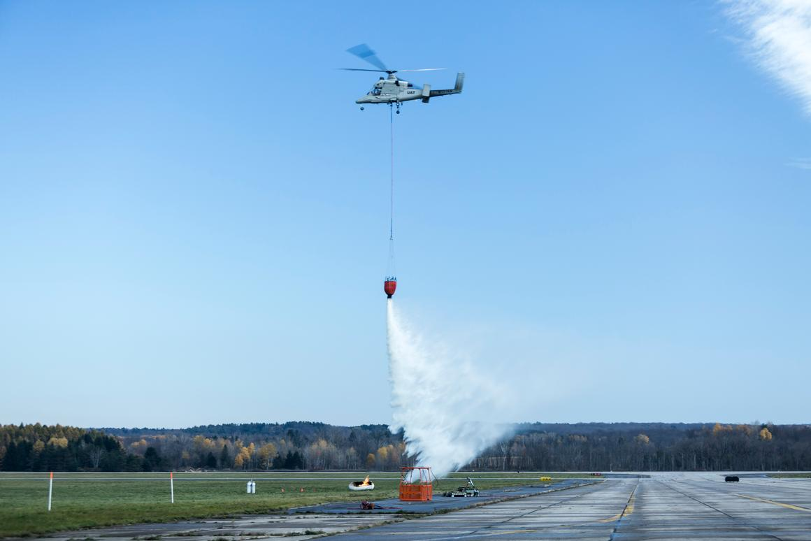 The K-MAX drops a payload of water, which it autonomously lifted from a pond