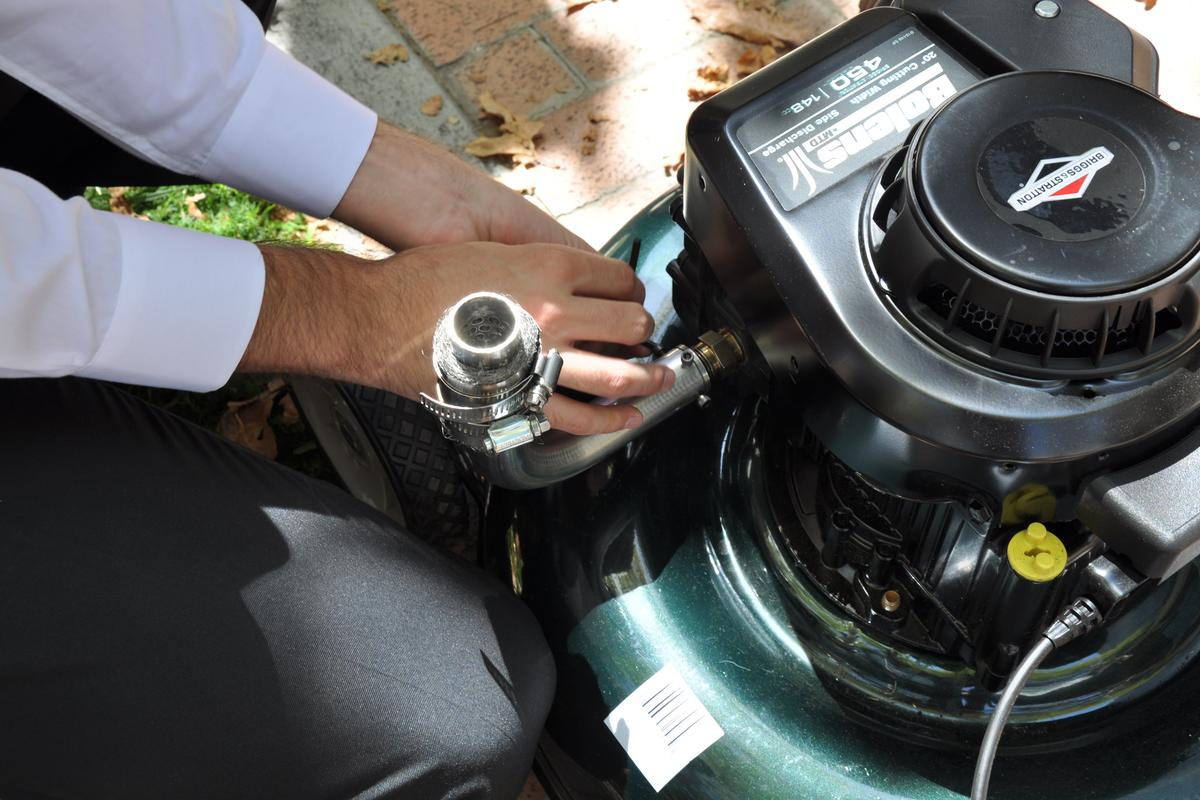 The UCR NOx-Out device replaces the muffler on an existing gas mower