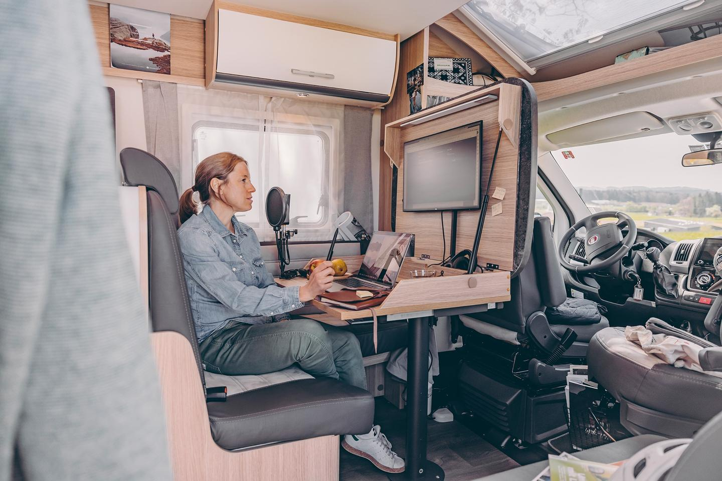 With a simple flip of the table, Sunlight's T68 motorhome becomes a Home Office on Wheels