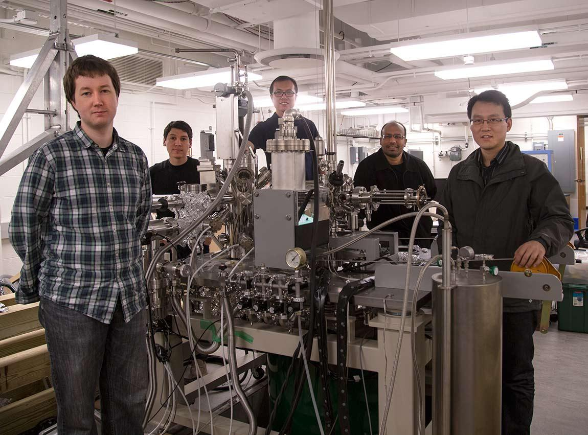 Researchers from Princeton's Department of Physics, (from left to right) graduate students Ilya Belopolski and Daniel Sanchez; postdoctoral research associate Guang Bian, professor of physics M. Zahid Hasan, and associate research scholar Hao Zheng.