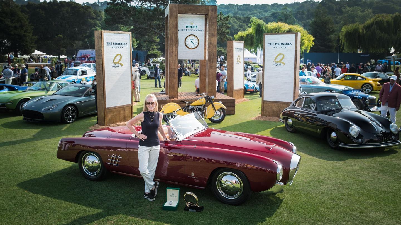 The Rolex Circle of Champions, andthe 'Best of Show' Award Winner,Anne Brockinton Lee, and her stunning 1953 Lancia Aurelia Pinin Farina200C
