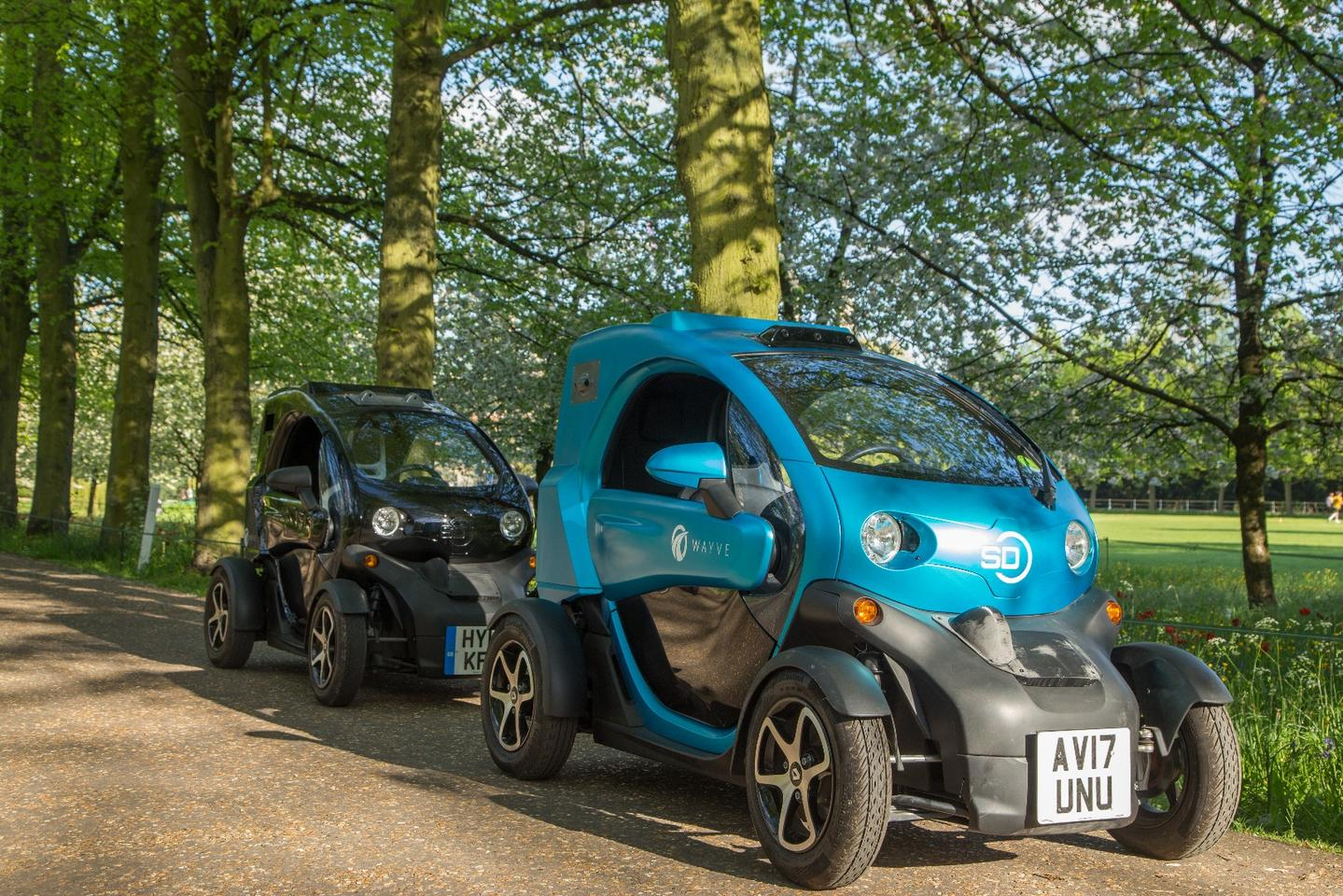 A pair of Renault Twizys, kitted out as self-driving test beds