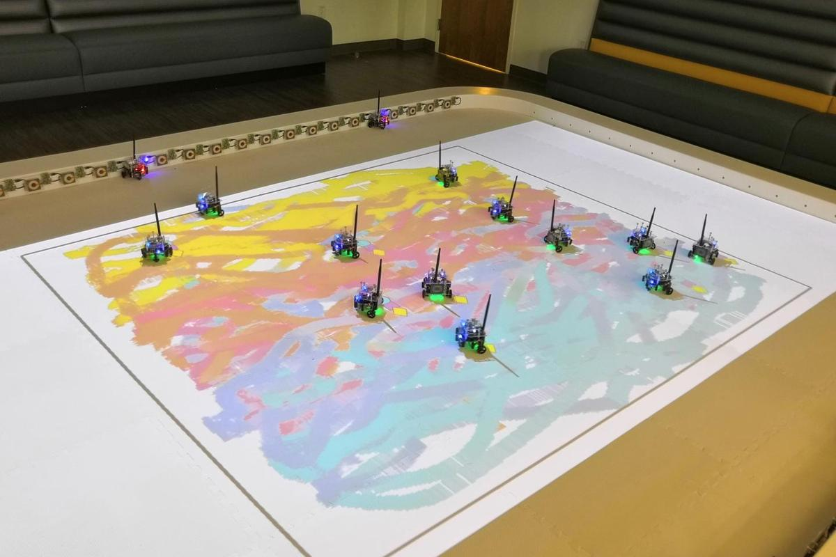 "The ""painting"" robots in action – although they're currently limited to creating fairly abstract works, they should be able to produce more refined images once the technology is developed further"
