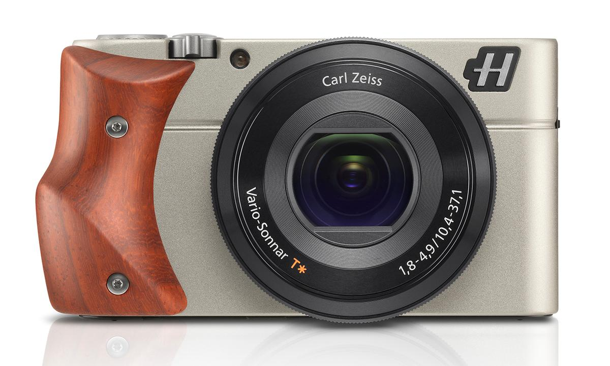 The Hasselblad Stellar is a luxury compact camera modelled on the Sony RX100, pictured with a Padouk Wood hand-grip