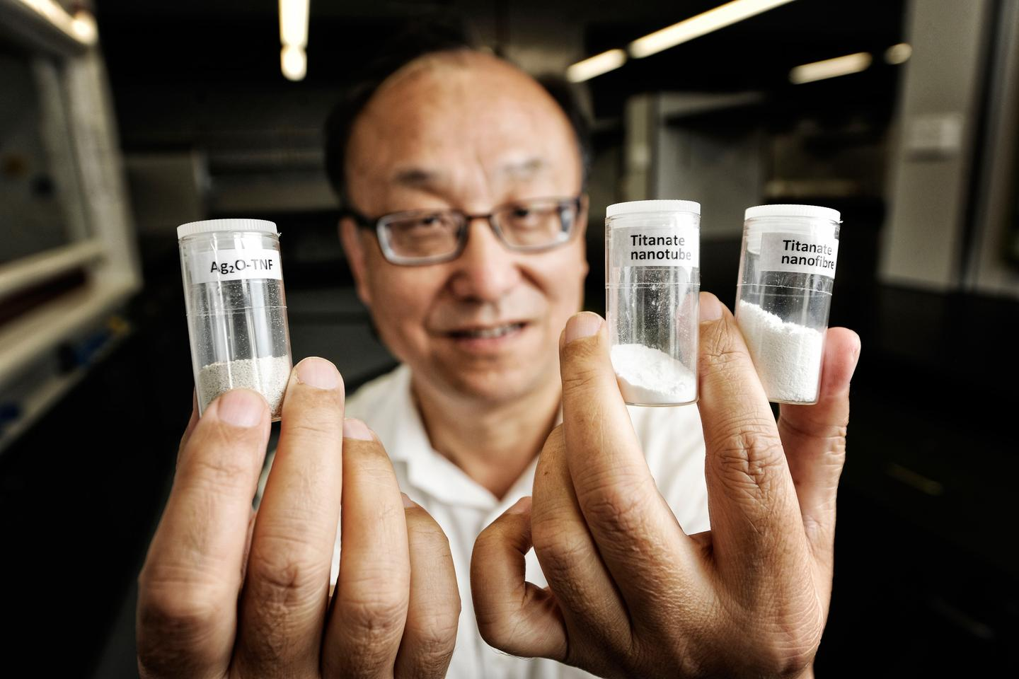 Professor Huai-Yong Zhu from QUT Chemistry with the titanate nanofiber that can remove radioactive material from contaminated water