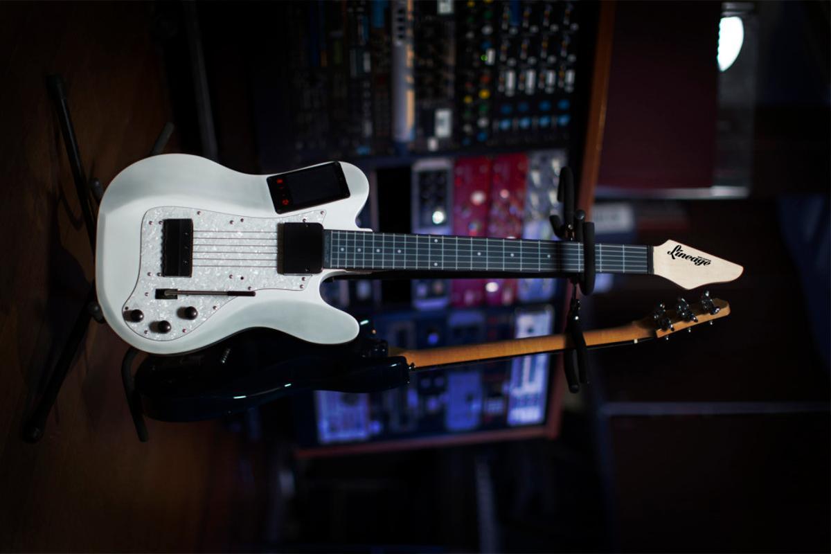 The white model of the Lineage MIDI guitar