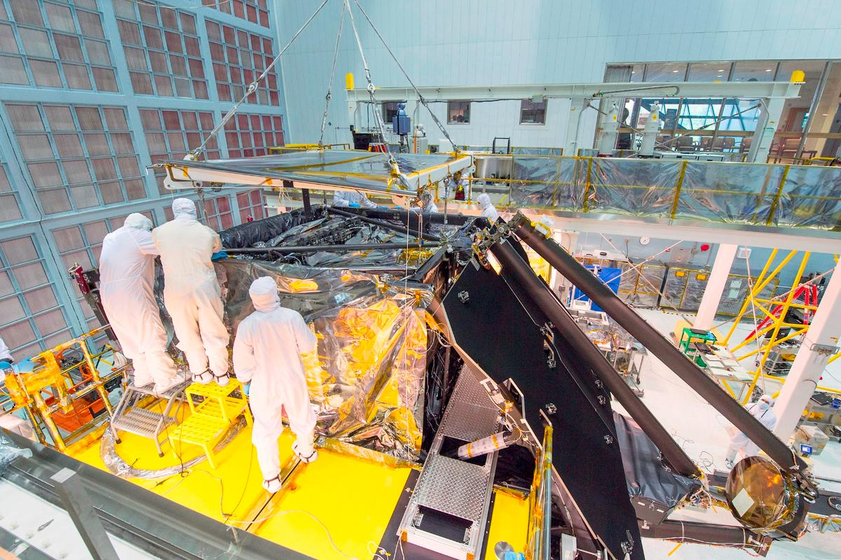 NASA engineers at work installing the JWST science payload