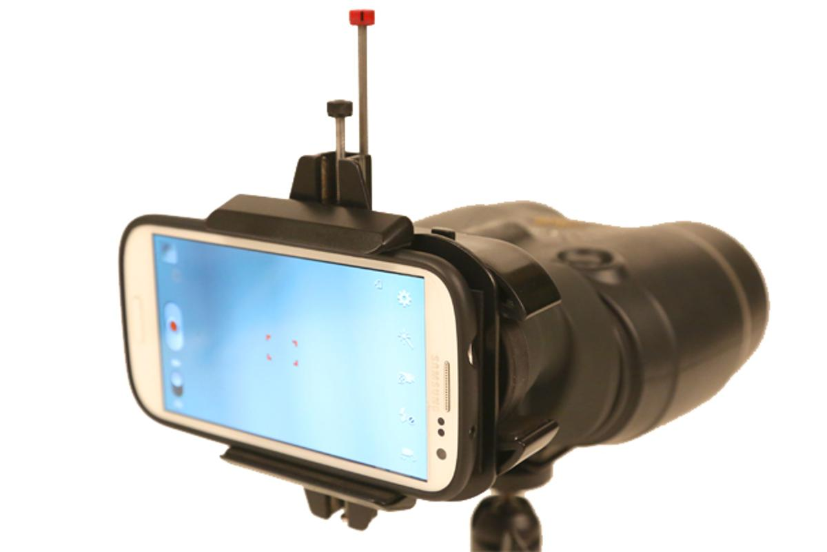 The Snapzoom allows you to attach your smartphone to a pair of binoculars