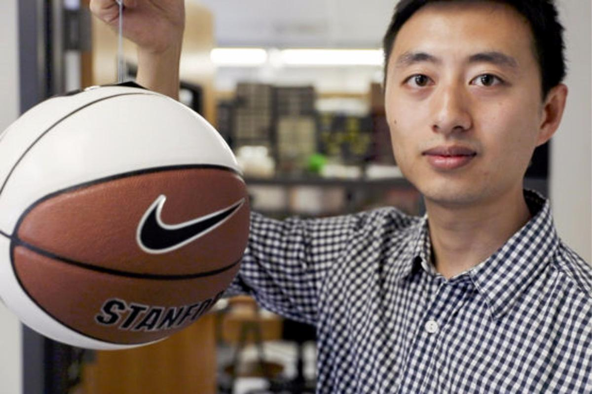 Hao Jiang, graduate student in the Cutkosky lab, shows a basketball being gripped by the gecko-inspired adhesive
