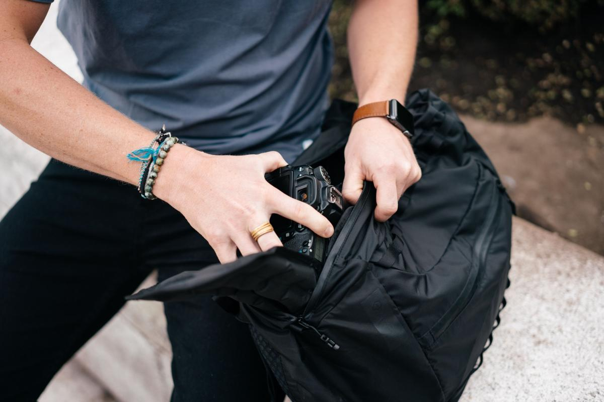 The Veer 18L Pack has an inflatable back panel for comfort and an inflatable cube to protect expensive camera gear