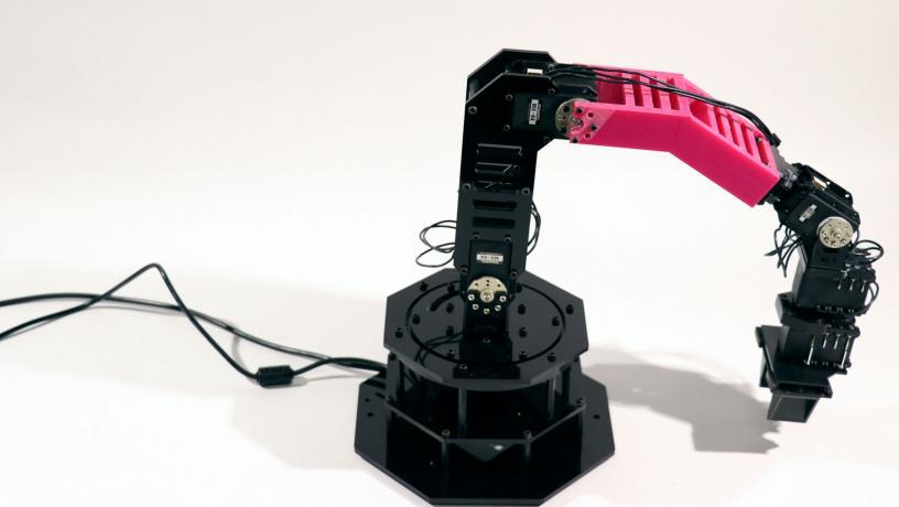 As part of its tests, the team 3D printed a new part (pink) that changed the arm's shape, and it was able to adjust its internal model of itself and get back to work