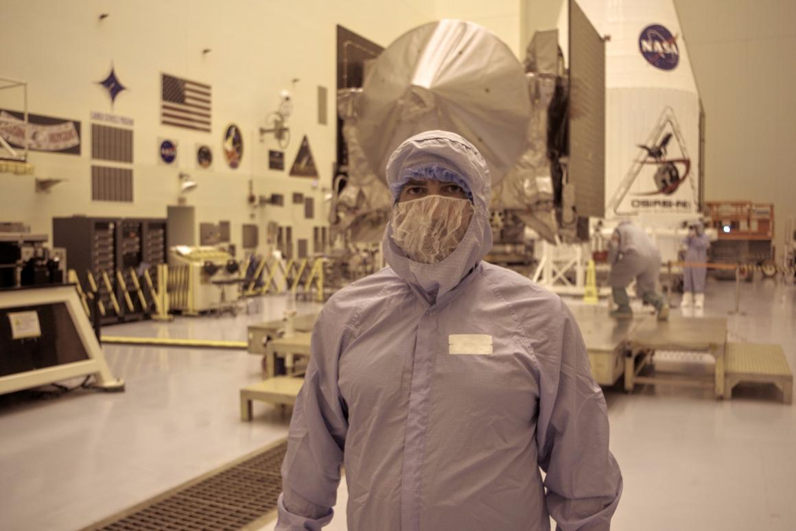 NASA takes it's clean room precautions seriously, but it's hard to take a journalist dressed like this the same way