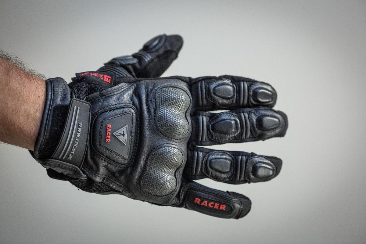 Racer Mickey gloves: SuperFabric on the knuckle and scaphoid armour reduce the glove's grip on the road during a slide