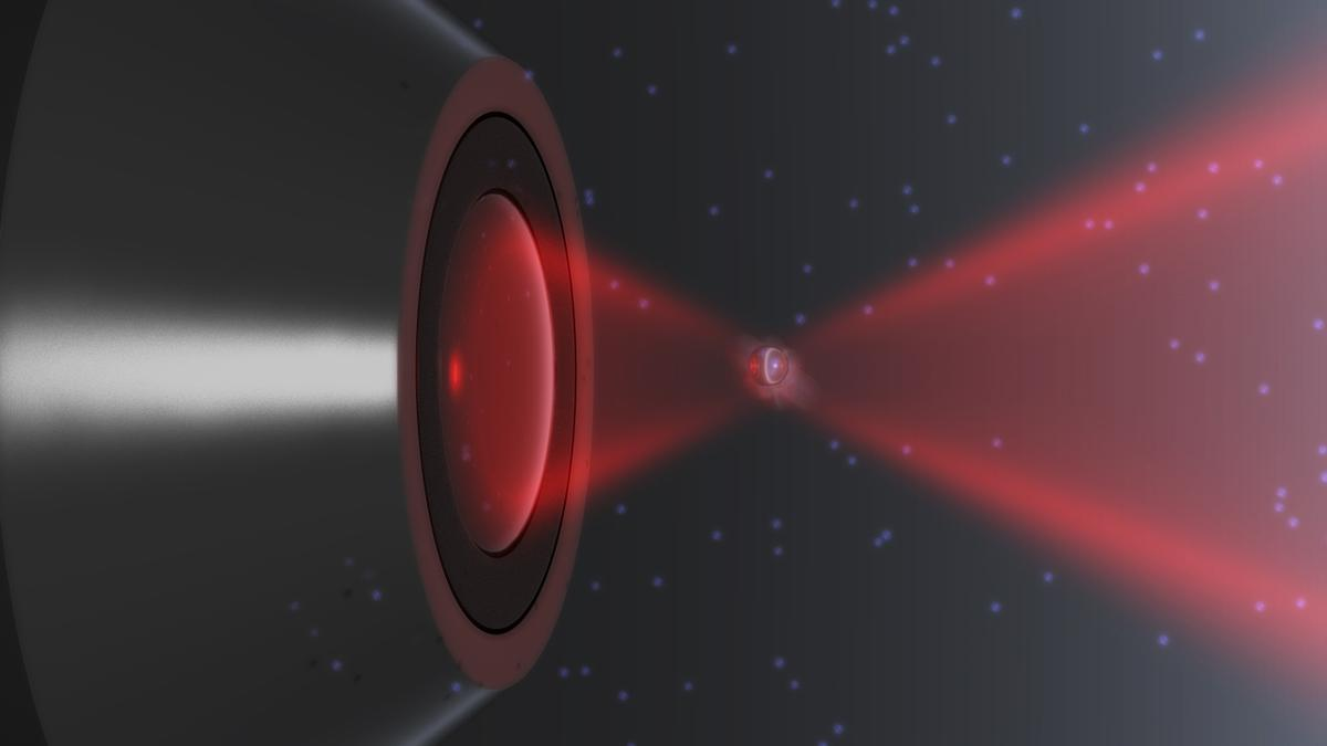 A rendering of a nanoparticle trapped in a laser and in thermal non-equilibrium (Image: Iñaki Gonzalez and Jan Gieseler)