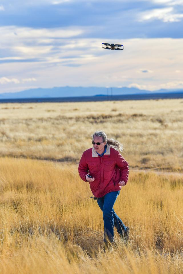 An unmanned aircraft system tracks and follows Sandia National Laboratories researcher David Novick