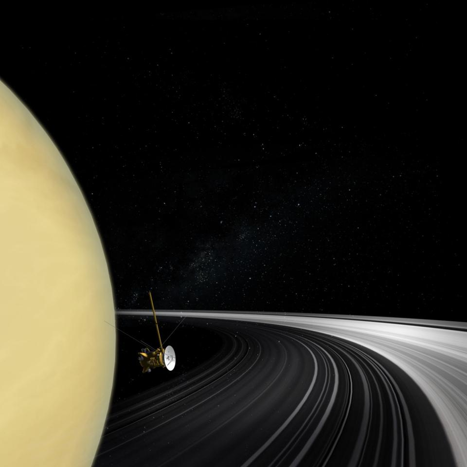 An artist's concept of the Cassini orbiter crossing Saturn's ring plane