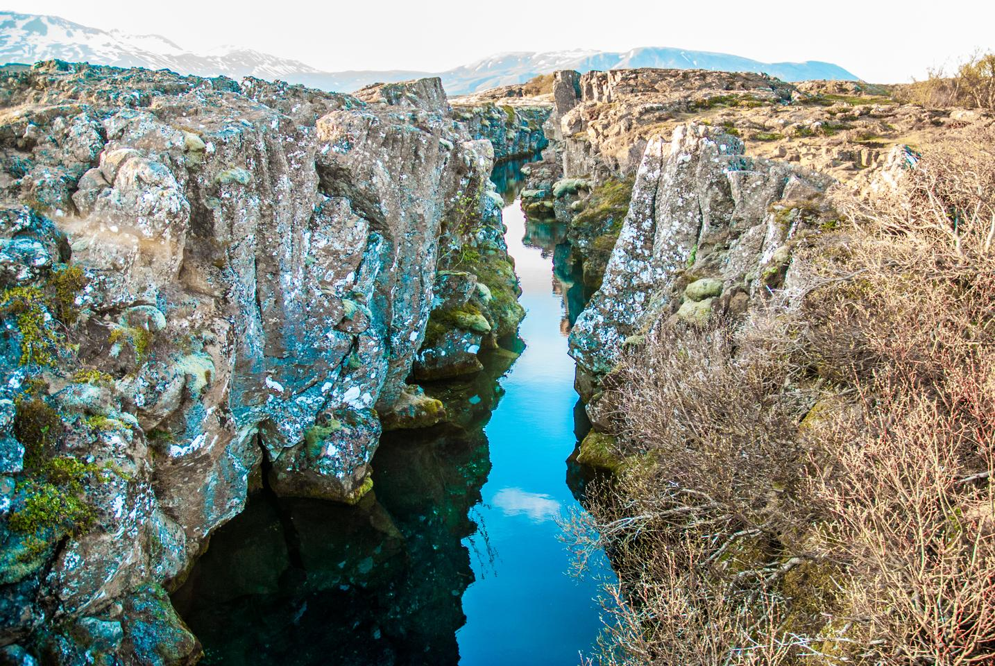 Thingvellir National park in Iceland features a valley created by two tectonic plates moving away from each other