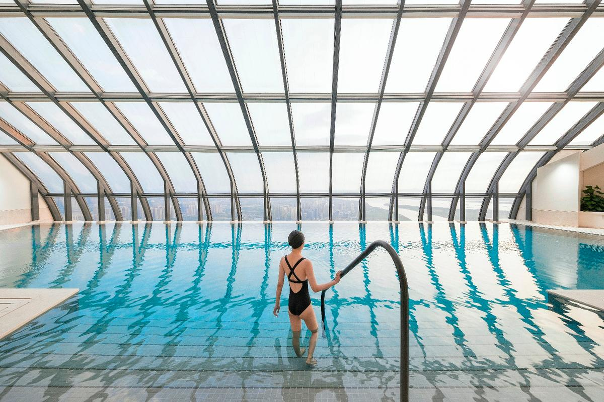 Though completed in 2015, the Nanjing International Youth Cultural Centre's interior recently received a new luxury hotel with a swimming pool near its top