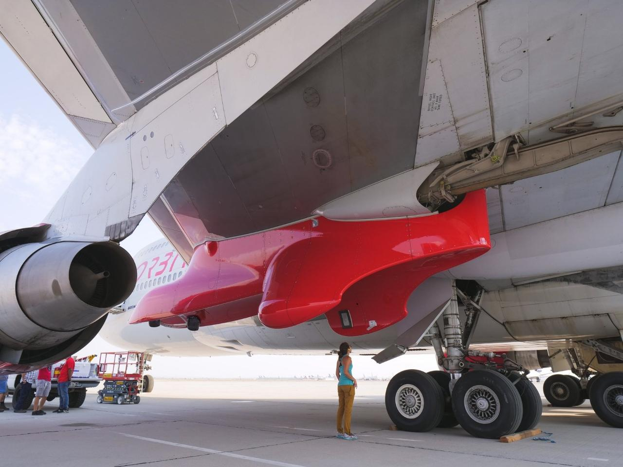 The pylon that will carry rockets aboard Virgin Orbit's Cosmic Girl mothership, seen in red