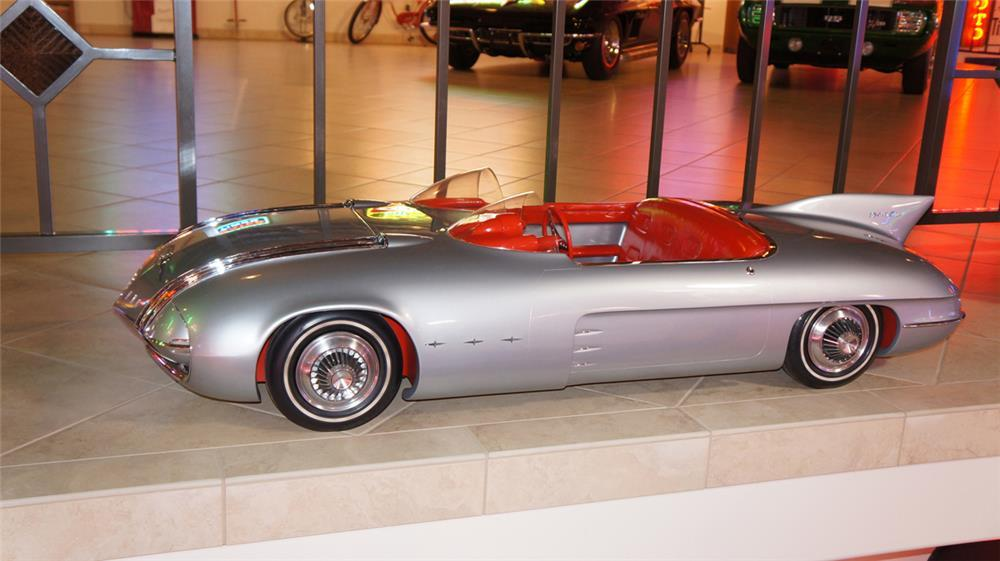 Originally constructed as a 3/8 scale model for display next to the full size car at General Motors' Motoramas, the car was destined for destruction until GM designer Harley Earl liberated the model and had it converted into an electric car for his grandchildren to play with. It is the only surviving remnant of GM's Club de Mer design. It sold for $33,925.