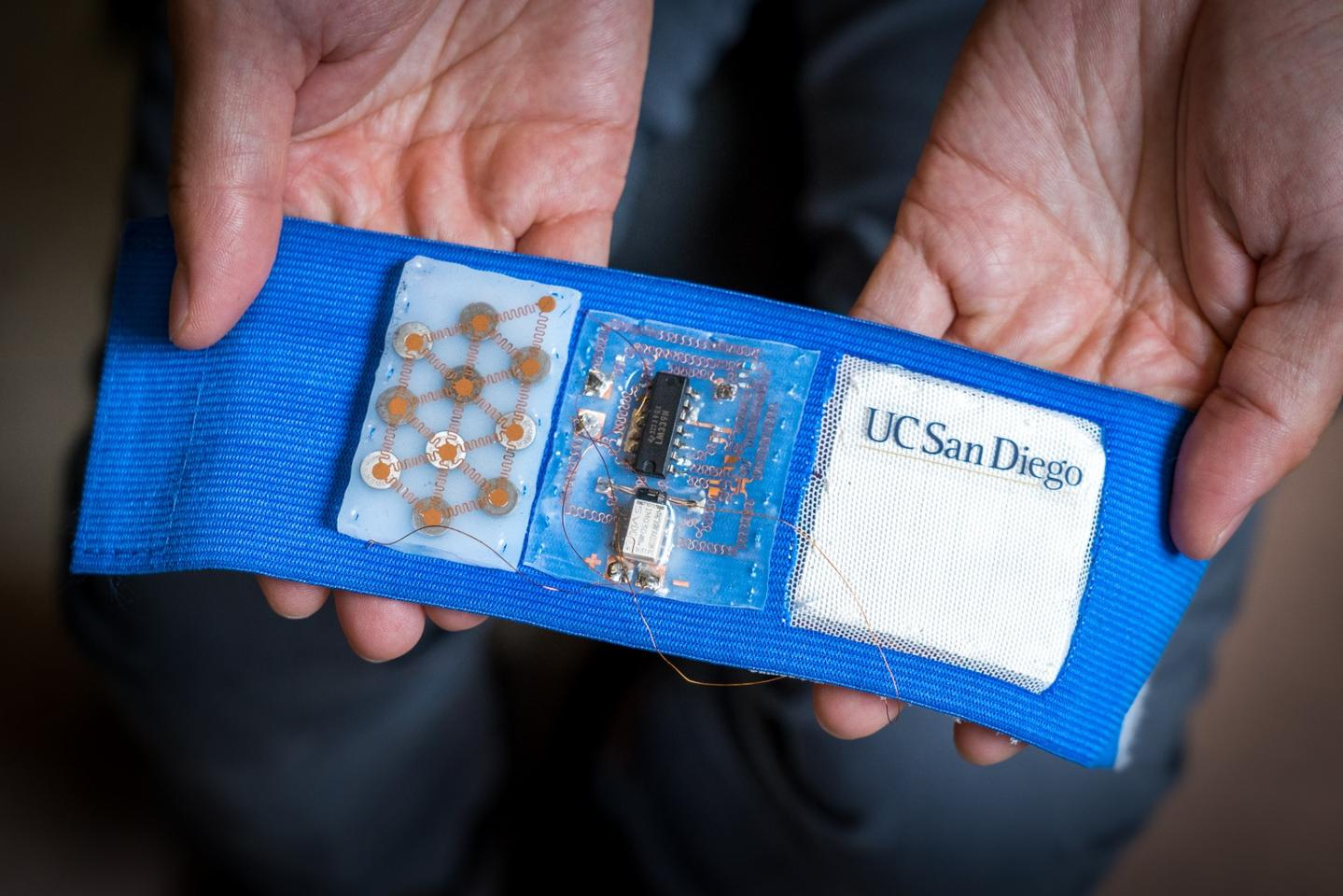 The proof-of-concept armband features a flexible battery, a stretchable circuit board, and a patch made up of thermoelectric alloys sandwiched between elastomer sheets