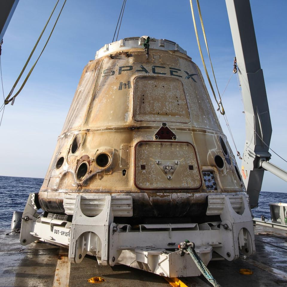 Recovered Dragon spacecraft following its safe splashdown in the Pacific Ocean