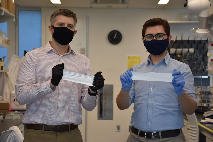 Daniel Roxbury (left) and Mohammad Moein Safaee with pieces of the smart bandage material