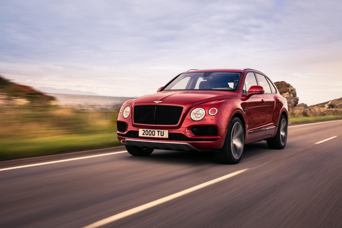 The Bentley Bentayga V8 has a black and chrome grille