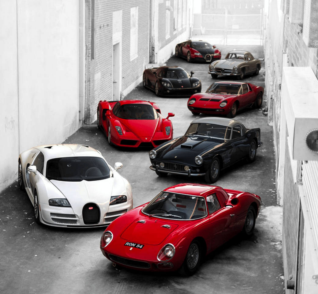 Just a fraction of what's on offer from the Pinnacle Portfolio, from front to back being the 1964 Earl's Court Motor Show Ferrari 250 LM, 2012 Bugatti Veyron 16.4 Super Sport, 1959 Ferrari 250 GT LWB California Spider, the Pope's 2005 Ferrari Enzo, 1971 Lamborghini Miura P400 SV, 2008 Koenigsegg CCXR, 1955 Mercedes-Benz 300 SL Alloy Gullwing, and the first production Bugatti Veyron 16.4 built.