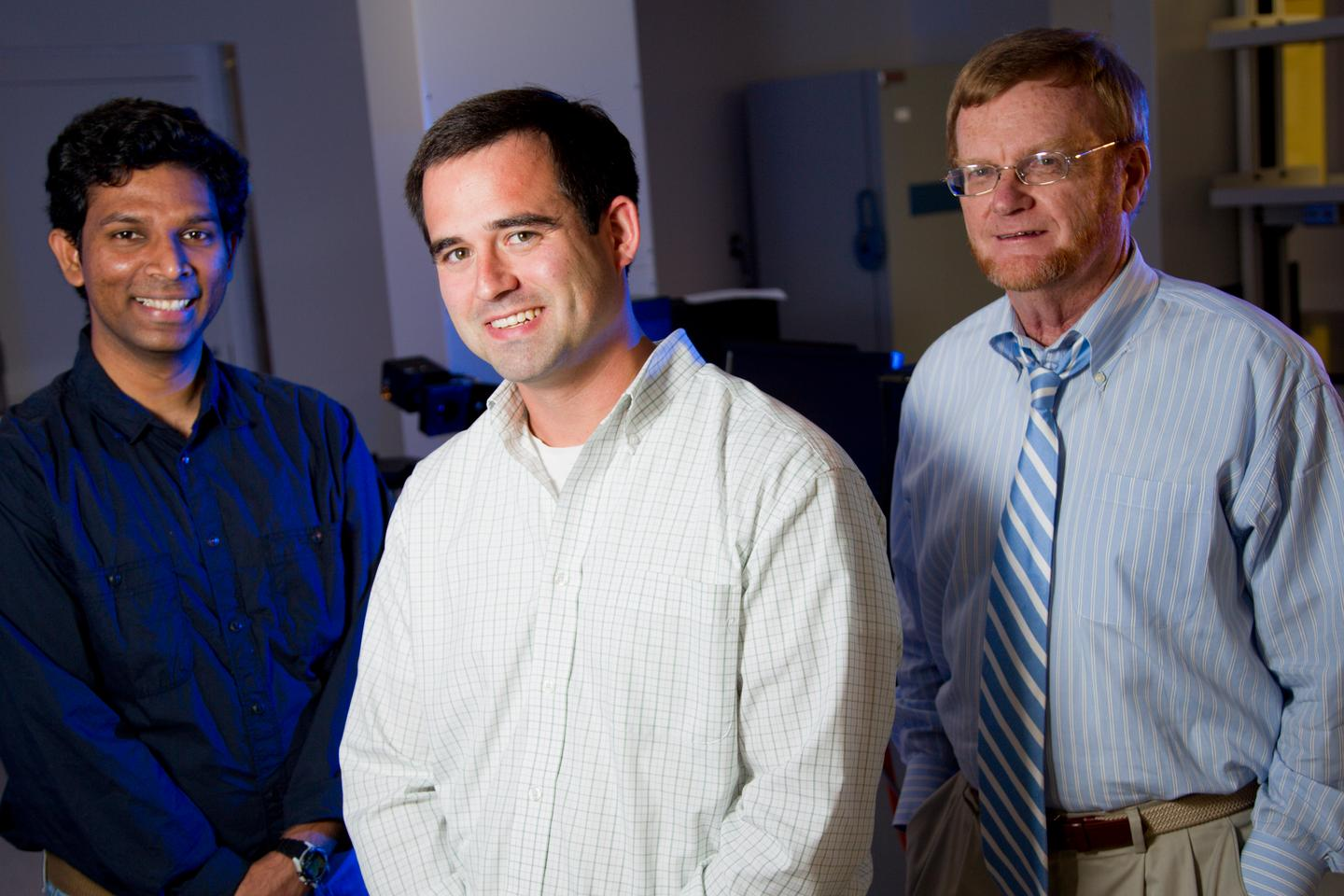 Antibacterial coating inventor Jason Locklin is surrounded by his project team; (left) Vikram Dhende, graduate student, and (right) Ian Hardin, a professor in the College of Family and Consumer Sciences (Photo: University of Georgia)