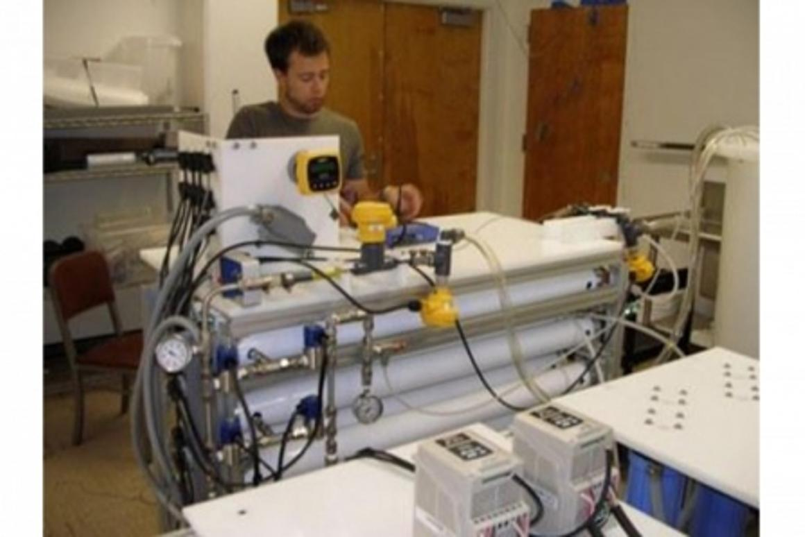 Graduate student Alex Bartman works with the M3 water filtration and desalination system (Photo: UCLA Newsroom)