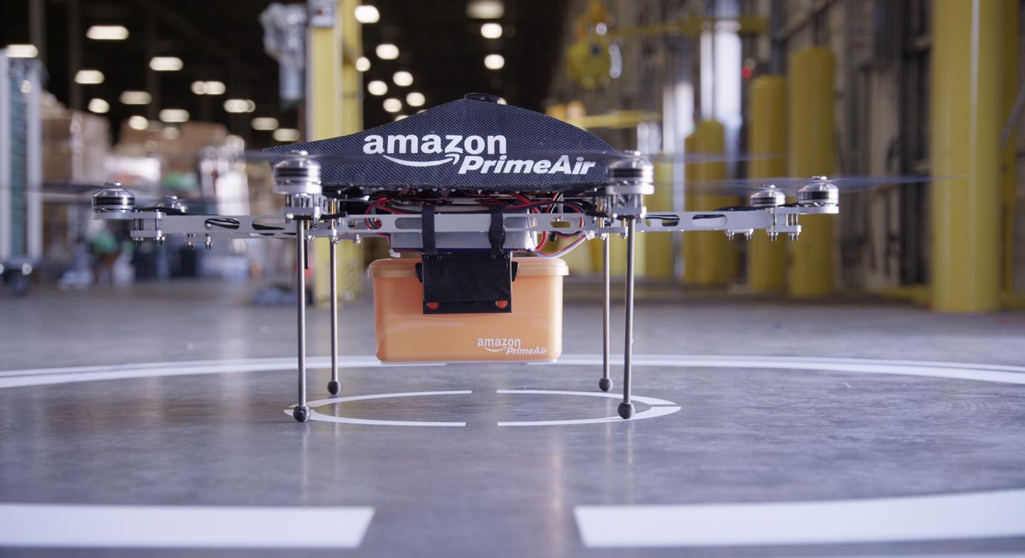 """Orders are placed in small plastic containers and then carried by the custom-built """"octocopter"""""""